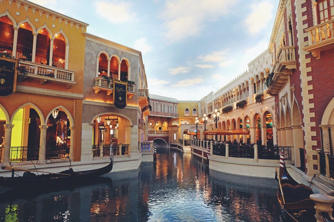 A group of people standing in front of The Venetian Las Vegas